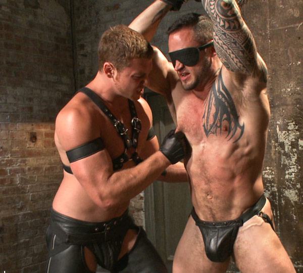 Leather hunk Connor Maguire flogs and fucks his bound slave
